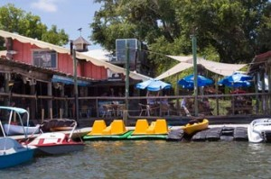 water front restaurant paddle boards kayaks electric boat rental