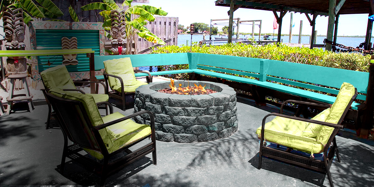 relaxing outdoor fire pit at hidden treasure tiki bar and grill port orange