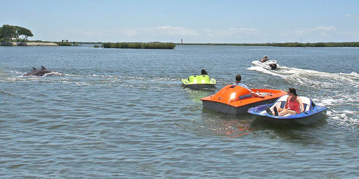 vacationers enjoying electric boats on rose bay port orange water sports